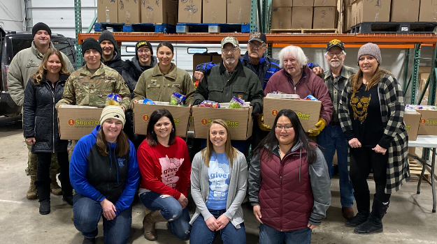 UWNEMN volunteers and staff with packed meal kits for local veterans